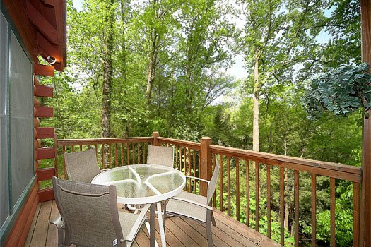Deck with patio table at Shiloh, a 3 bedroom cabin rental located in Gatlinburg