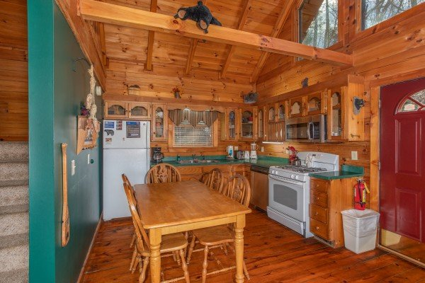 Kitchen with dining table for five at Shiloh, a 3 bedroom cabin rental located in Gatlinburg