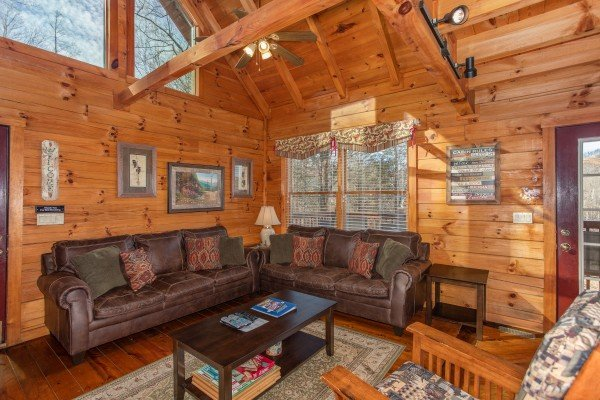 Living room with a sofa, loveseat, and vaulted ceiling at Shiloh, a 3 bedroom cabin rental located in Gatlinburg