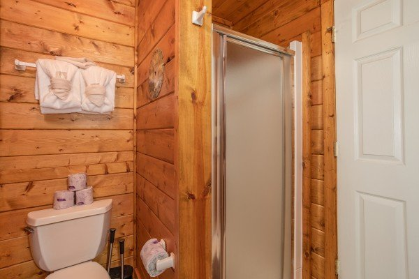 Bathroom with a shower stall on the lower floor at Shiloh, a 3 bedroom cabin rental located in Gatlinburg