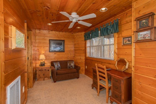 Twin sleeper sofa on the lower floor at Shiloh, a 3 bedroom cabin rental located in Gatlinburg