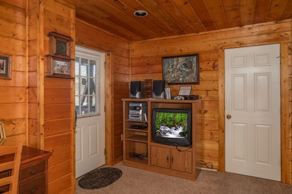 Television in an entertainment center on the lower floor at Shiloh, a 3 bedroom cabin rental located in Gatlinburg