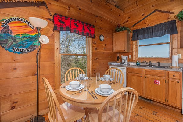 Dining table for four at Lumber Jack Lodge, a 1 bedroom cabin rental located in Gatlinburg