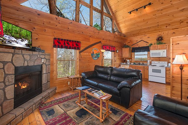 Main floor with an open concept layout and high ceiling with large windows at Lumber Jack Lodge, a 1 bedroom cabin rental located in Gatlinburg