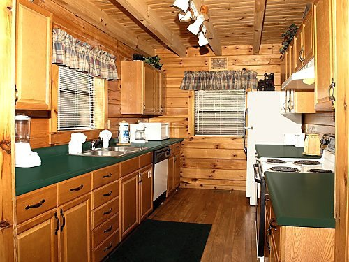 galley kitchen at mountain mist a 1 bedroom cabin rental located in pigeon forge