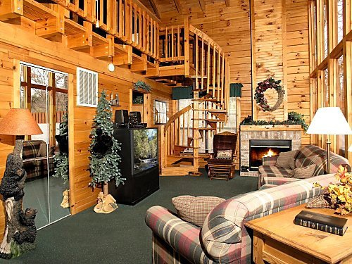 living room with balcony overlook at mountain mist a 1 bedroom cabin rental located in pigeon forge