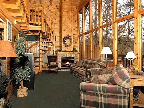 living room with fireplace at mountain mist a 1 bedroom cabin rental located in pigeon forge