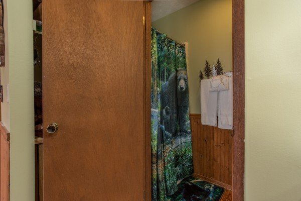 Bathroom off the bedroom space at Bear Mountain Hollow, a 1 bedroom cabin rental located in Pigeon Forge