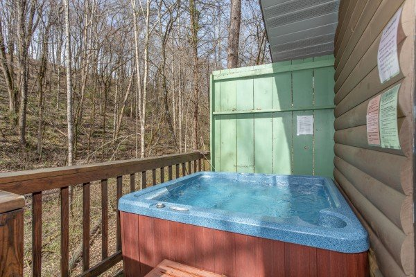 Hot tub and privacy fence on the deck at Bear Mountain Hollow, a 1 bedroom cabin rental located in Pigeon Forge
