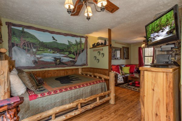 Bedroom space at Bear Mountain Hollow, a 1 bedroom cabin rental located in Pigeon Forge