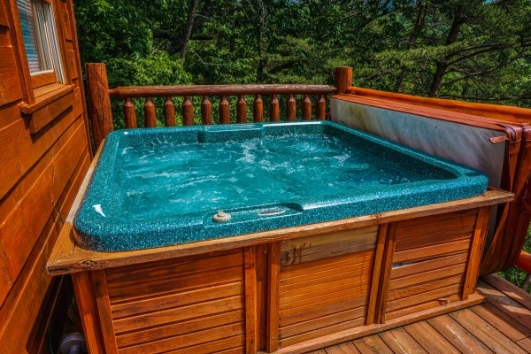 Hot tub on the deck at Deerly Beloved, a 1-bedroom cabin rental located in Gatlinburg