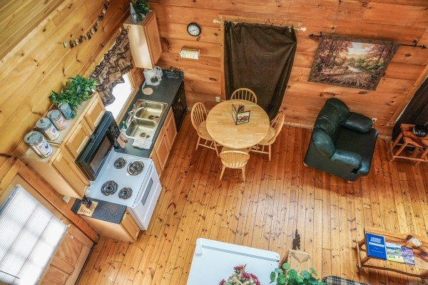 looking down into the kitchen at deerly beloved a 1 bedroom cabin rental located in gatlinburg