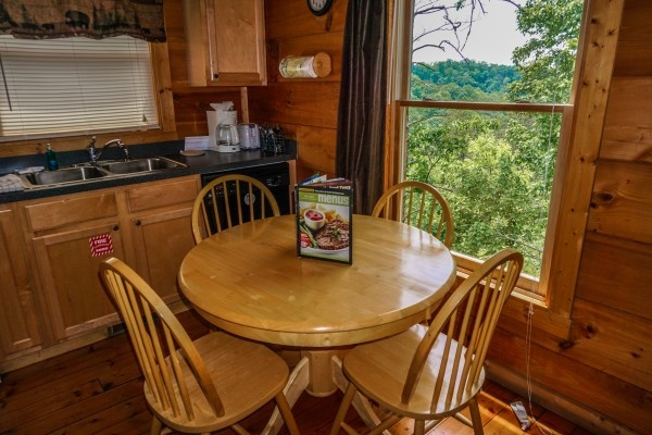 Kitchen table with seating for four at Deerly Beloved, a 1-bedroom cabin rental located in Gatlinburg