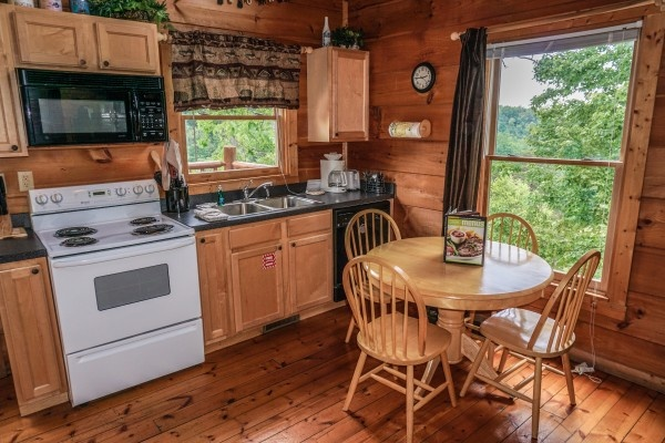 kitchen with table at deerly beloved a 1 bedroom cabin rental located in gatlinburg