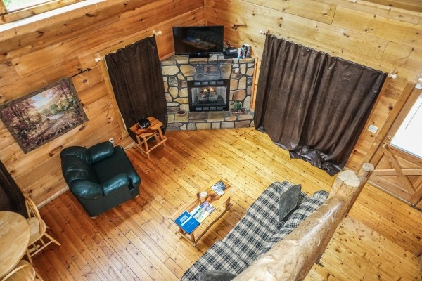 view looking down into living room at deerly beloved a 1 bedroom cabin rental located in gatlinburg