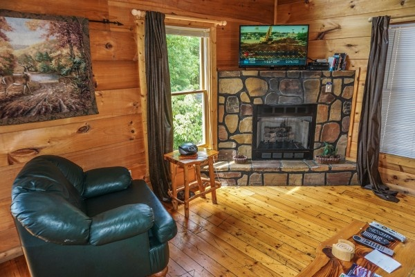 Seating in living room at Deerly Beloved, a 1-bedroom cabin rental located in Gatlinburg