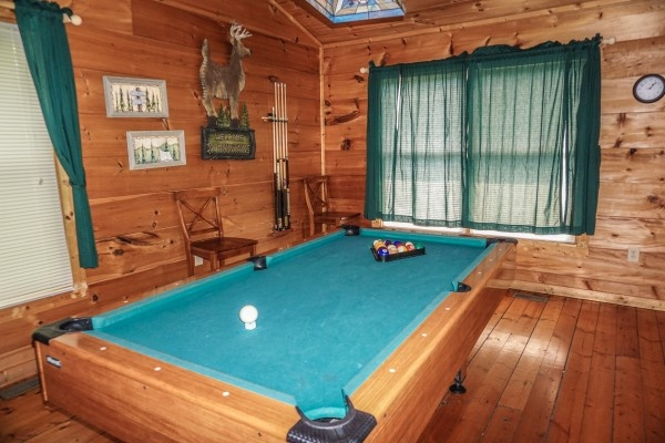 Lofted game room at Deerly Beloved, a 1-bedroom cabin rental located in Gatlinburg