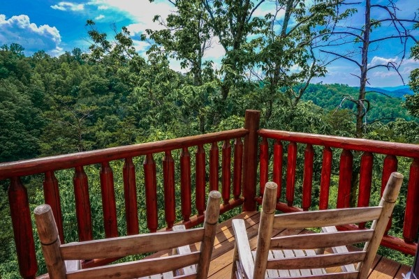 See the Smokies from the deck at Deerly Beloved, a 1-bedroom cabin rental located in Gatlinburg