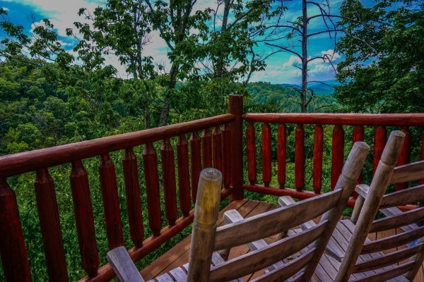 View of the Smoky Mountains from the rockers on the deck at Deerly Beloved, a 1-bedroom cabin rental located in Gatlinburg