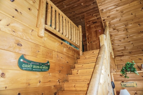 stairs up to lofted gameroom at deerly beloved a 1 bedroom cabin rental located in gatlinburg