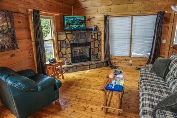 stone fireplace at deerly beloved a 1 bedroom cabin rental located in gatlinburg
