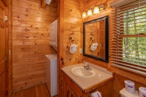 Bathroom with a stacked washer and dryer at Dreams Do Come True, a 1-bedroom cabin rental located in Pigeon Forge