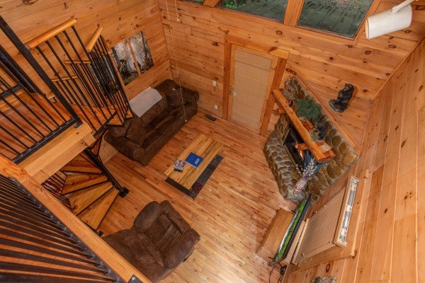 Living room from the game loft at Dreams Do Come True, a 1-bedroom cabin rental located in Pigeon Forge