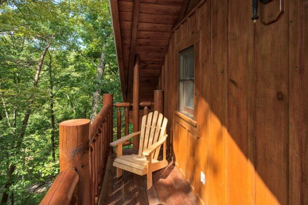 Deck off the game room at Dreams Do Come True, a 1-bedroom cabin rental located in Pigeon Forge