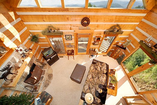 Looking down into the living room from the upper floor at Sweet Serenity, a 1 bedroom cabin rental located in Pigeon Forge