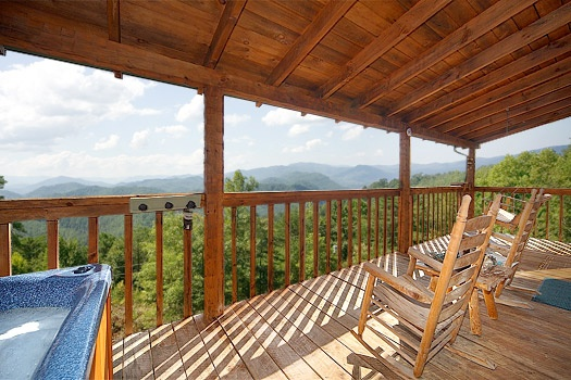 Covered deck with rockers at Sweet Serenity, a 1 bedroom cabin rental located in Pigeon Forge