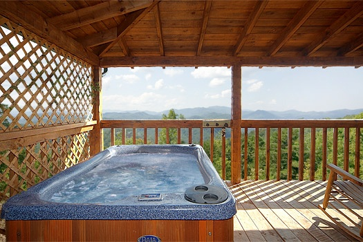 Covered deck with hot tub at Sweet Serenity, a 1 bedroom cabin rental located in Pigeon Forge