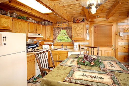 kitchen and dining area at sweet serenity a 1 bedroom cabin rental located in pigeon forge