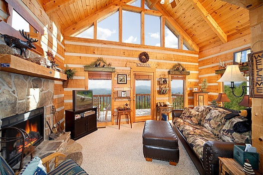 Living room with fireplace at Sweet Serenity, a 1 bedroom cabin rental located in Pigeon Forge