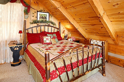 Queen sized bed at Sweet Serenity, a 1 bedroom cabin rental located in Pigeon Forge