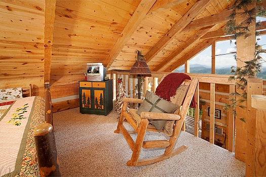 Rocking chair and TV in the loft at Sweet Serenity, a 1 bedroom cabin rental located in Pigeon Forge