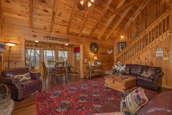 Living room and dining space at Bearfoot Adventure, a Gatlinburg Cabin rental