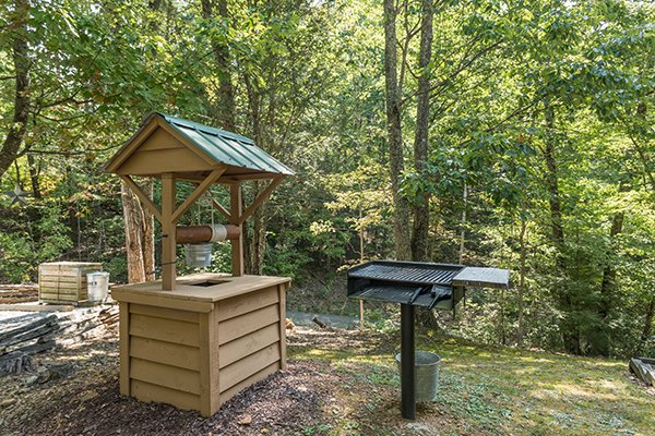 Charcoal grill and wishing well at bearfoot adventure a 2 bedroom cabin rental located in gatlinburg