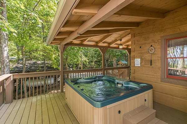 Hot tub on the deck, under cover from the elements at bearfoot adventure a 2 bedroom cabin rental located in gatlinburg