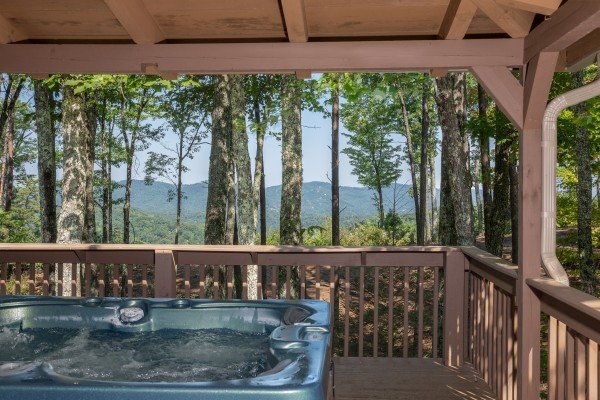 Mountain views from the hot tub on a covered deck at bearfoot adventure a 2 bedroom cabin rental located in gatlinburg