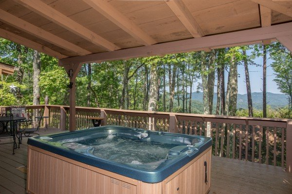 Mountain views from the hot tub at bearfoot adventure a 2 bedroom cabin rental located in gatlinburg