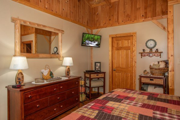 Dresser and TV in the loft bedroom at Bearfoot Adventure, a Gatlinburg Cabin rental