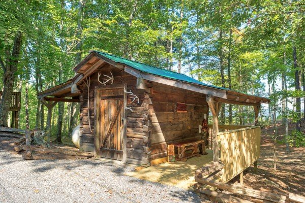 Tiny decorative cabin in the driveway at bearfoot adventure a 2 bedroom cabin rental located in gatlinburg