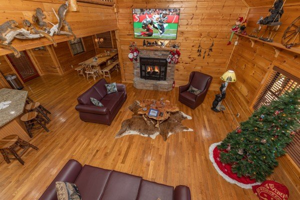 Looking down at the living room at 3 Crazy Cubs, a 5 bedroom cabin rental located in Pigeon Forge