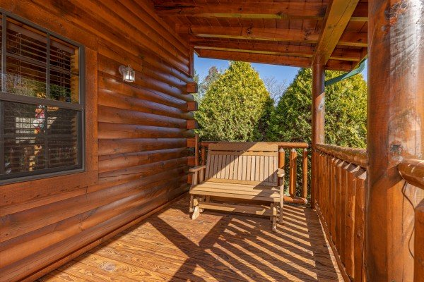 Glider on a covered deck at 3 Crazy Cubs, a 5 bedroom cabin rental located in Pigeon Forge