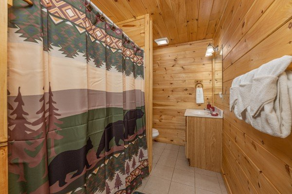 Bathroom with a tub and shower at 3 Crazy Cubs, a 5 bedroom cabin rental located in Pigeon Forge