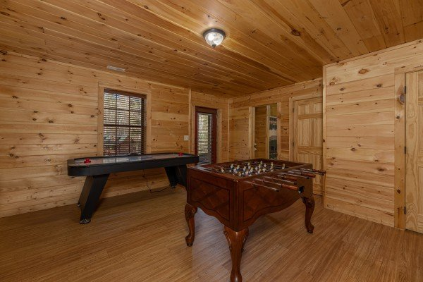 Foosball and shuffleboard in the game room at 3 Crazy Cubs, a 5 bedroom cabin rental located in Pigeon Forge