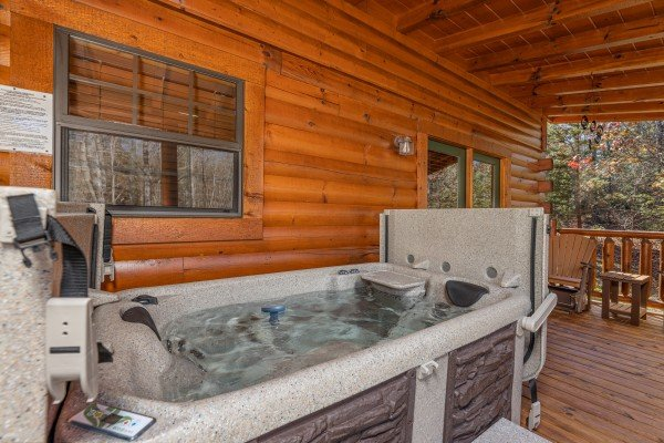 Hot tub on a covered deck at 3 Crazy Cubs, a 5 bedroom cabin rental located in Pigeon Forge