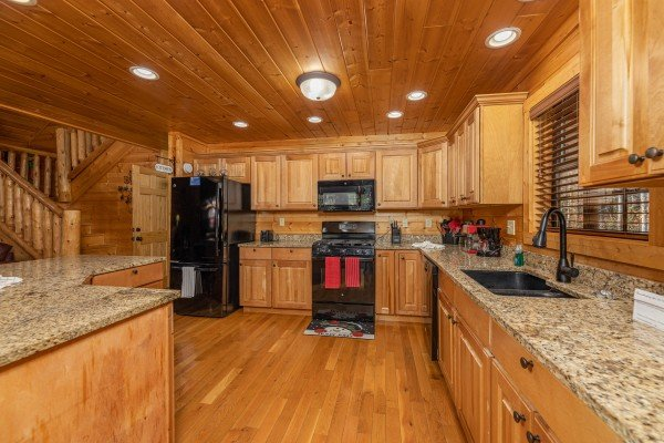 Kitchen with black appliances at 3 Crazy Cubs, a 5 bedroom cabin rental located in Pigeon Forge