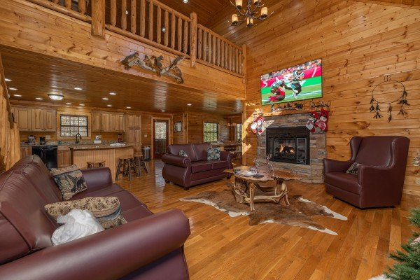 Living room with fireplace and TV at 3 Crazy Cubs, a 5 bedroom cabin rental located in Pigeon Forge