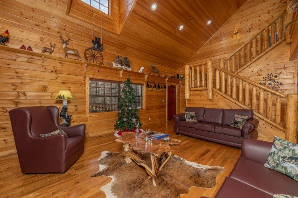 Sofa and chair in the living room at 3 Crazy Cubs, a 5 bedroom cabin rental located in Pigeon Forge